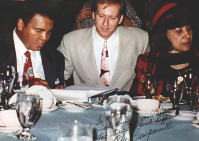 Mark at a charity dinner with Muhammad Ali