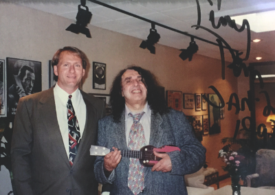Mark posing with music client, Tiny Tim