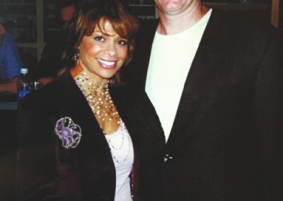 Mark posing at an event with Paula Abdul